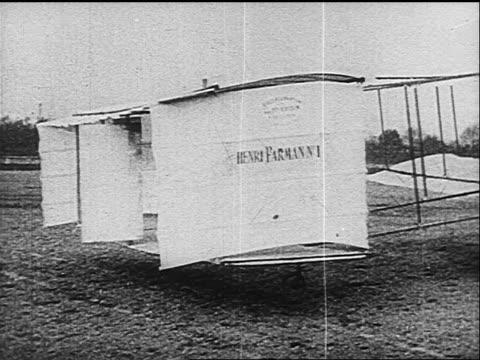 pan men working on henri farman's first airplane - wright flyer stock-videos und b-roll-filmmaterial