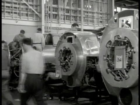 men working on incomplete airplane engines in factory. newspaper clippings 'aircraft strike ties up orders of $50 000 000' 'c.i.o. strike shuts war... - newspaper strike stock videos & royalty-free footage
