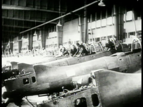 men working on junkers ju-88 airplanes lined up side by side. men working on airplane bodies. luftwaffe fighter airplanes lined up outside factory... - germany stock videos & royalty-free footage
