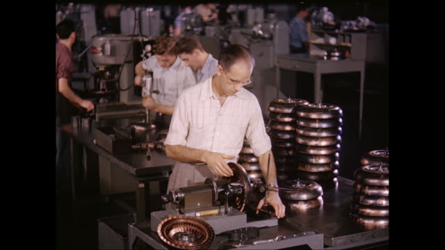 ms men working on machinery in factory / united states - 1960 stock-videos und b-roll-filmmaterial
