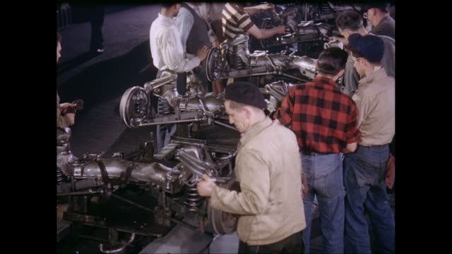 ms men working on machinery in factory / united states - 1960 stock videos & royalty-free footage