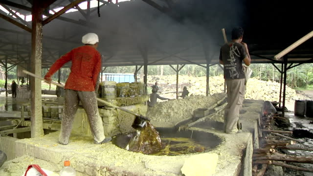 MS Men working on the boilers of the sulfur mining / Ijen, Java, Indonesia