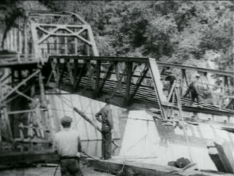 B/W 1934 men working on truss bridge under construction by WPA / documentary