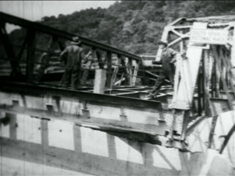 b/w 1934 men working on truss bridge under construction by wpa / documentary - bridge built structure stock videos and b-roll footage