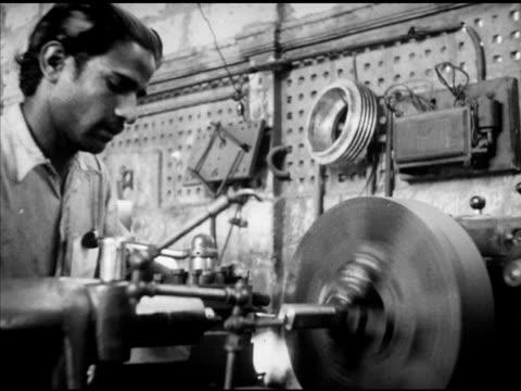 men working sanding or polishing item by hand table leg shape vs men working w/ horizontal lathe boring shaping or making copy of shape pakistani... - sander stock videos and b-roll footage