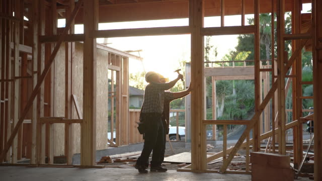 ws men working together building a house - building activity stock videos & royalty-free footage
