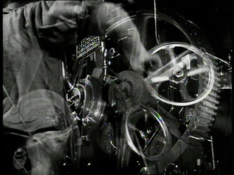 1940 multiple exposure men working with machinery in an automobile plant / detroit, michigan, united states - 1940 bildbanksvideor och videomaterial från bakom kulisserna