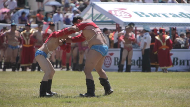 Men wrestling at Naadam Festival