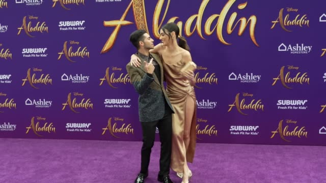 Mena Massoud and Laysla De Oliveira at the world premiere of Disney's Aladdin held at the El Capitan Theatre on May 21 2019 in Los Angeles California