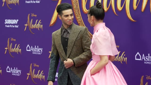 Mena Massoud and Naomi Scott at the world premiere of Disney's Aladdin held at the El Capitan Theatre on May 21 2019 in Los Angeles California