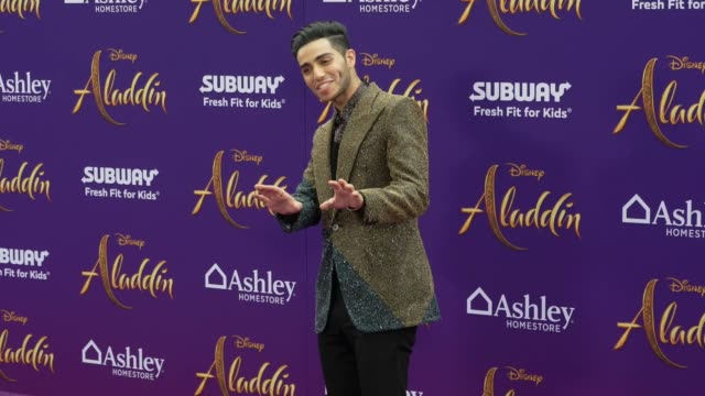 Mena Massoud at the world premiere of Disney's Aladdin held at the El Capitan Theatre on May 21 2019 in Los Angeles California