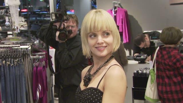 mena suvari at the h&m celebrity shopping event at los angeles ca. - mena suvari stock videos & royalty-free footage