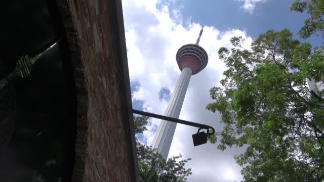 menara kuala lumpur - broadcasting tower - menara kuala lumpur tower stock videos & royalty-free footage