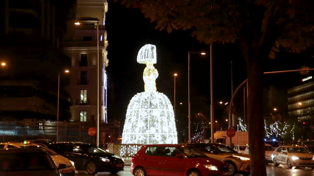 menina light sculpture stands at plaza de colón on november 27 in madrid, spain. the 10-meter tall sculpture, part of the christmas light decoration... - bright colour stock videos & royalty-free footage