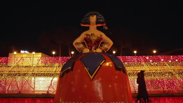 menina sculpture, named wonder woman 1984, designed by antonio azzato and sponsored by warner bros, stands at plaza de colón with the christmas... - light trail stock videos & royalty-free footage