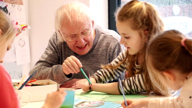 meningitis survivor painting on the dining room table with grandpa! - art and craft stock videos and b-roll footage