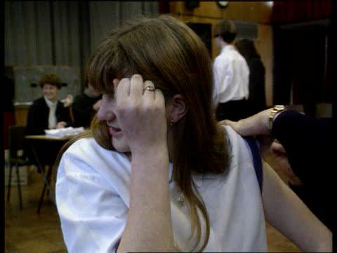 meningitis vaccination programme declared success lib dinnington comprehensive school cms schoolgirl flinching as receiving vaccination - south yorkshire stock videos and b-roll footage