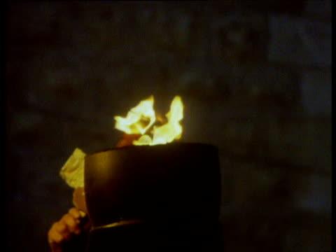 vídeos de stock, filmes e b-roll de menorah oil lamps are lit during jewish festival of hanukkah - candelabro