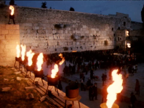 menorah oil lamps burn as orthodox jews assemble at western wall on eighth day of hanukkah jerusalem; 1970's - jerusalem old city stock videos and b-roll footage
