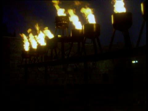 Menorah oil lamps burn as part of Jewish Hanukkah festival