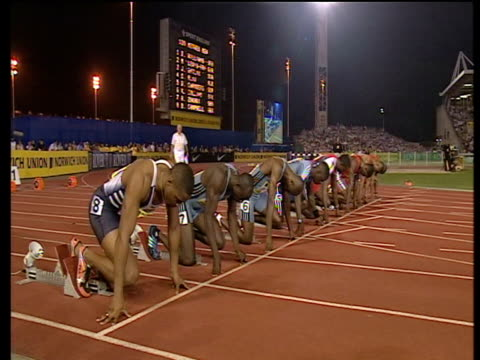 men's 100m finalists prepare to start race 2003 international athletics grand prix crystal palace london - athleticism stock videos & royalty-free footage