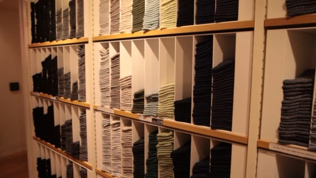 men's clothing at a uniqlo co store on 5th avenue in new york us on tuesday jan 21 wide shot of mannequin displaying men's clothing close up of... - flagship store stock videos and b-roll footage
