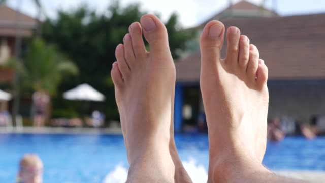 men's feet relaxing on a tropical resort - punta cana stock videos and b-roll footage