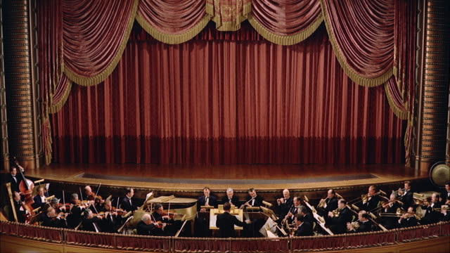 ws men's playing orchestra in pit of stage / new york, new york, united states - orchestra stock videos & royalty-free footage