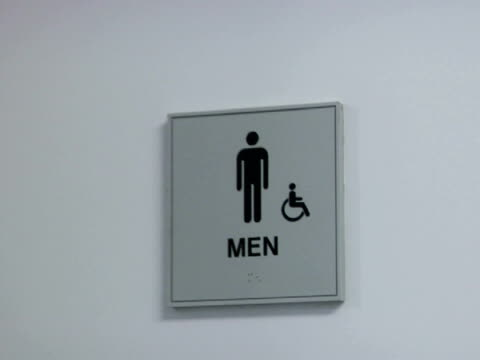 ms, men's restroom doors closing - figura maschile video stock e b–roll