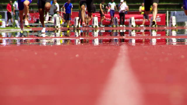 SLO MO Men's Running Track In The Summer Heat