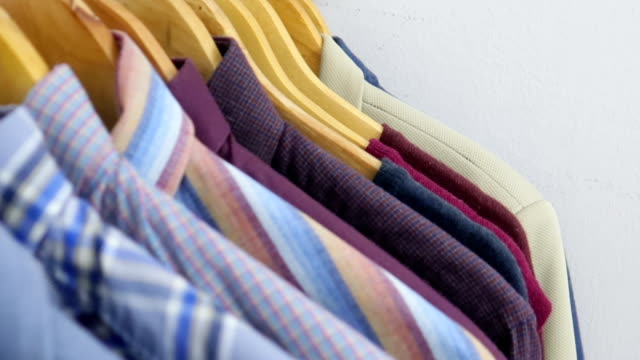 men's shirts on hangers - stock video - shirt stock videos & royalty-free footage