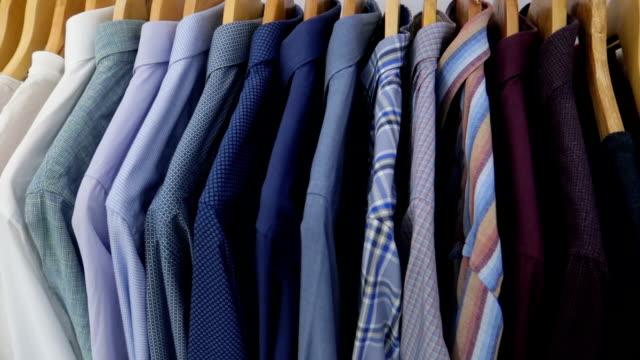Men's shirts on hangers - Stock video
