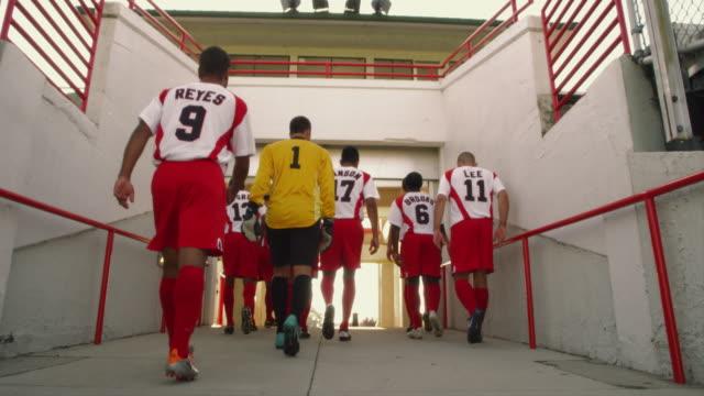 A men's soccer team walks away through a stadium door in Pennsylvania.