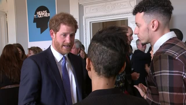 celebrities join duke and duchess of cambridge's heads together campaign; lib / 17.1.2017 int prince harry talking to people at reception held to... - face to face stock videos & royalty-free footage