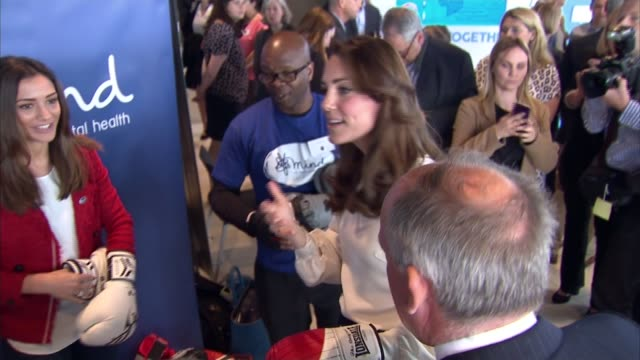 duke and duchess of cambridge and prince harry help launch heads together project; kate wearing boxing gloves / harry chatting to children with... - face to face stock videos & royalty-free footage