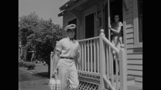 1948 a mentally ill woman interrupts a milkman during his delivery - milkman stock videos & royalty-free footage