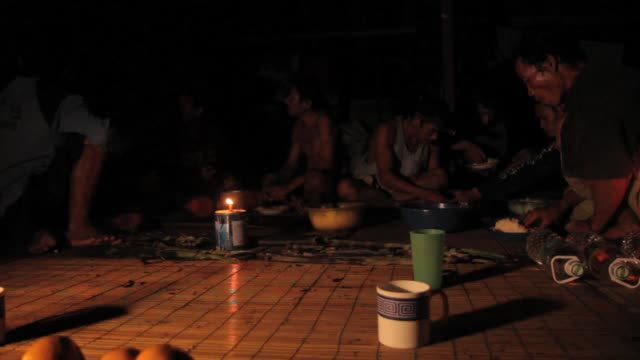mentawai community preparing to sleep at the communal house - indigene kultur stock-videos und b-roll-filmmaterial