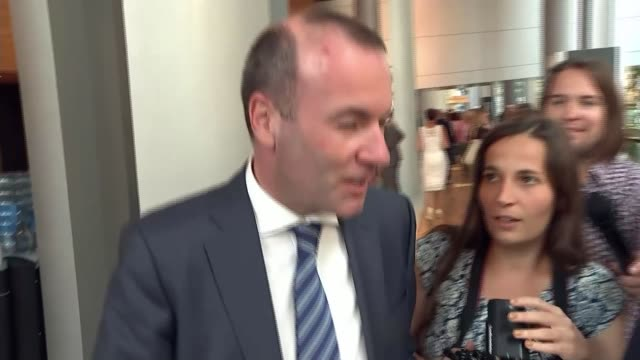 meps deciding on next head of european commission france strasbourg int manfred weber along and ignoring question from reporter - europäische kommission stock-videos und b-roll-filmmaterial
