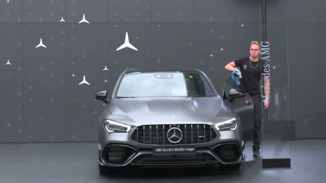 mercedes amg cla 45 s 4matic+ coupe stands on display in front of the hall, in which daimler ag is exhibiting its cars at the 2019 iaa frankfurt auto... - mercedes benz stock videos & royalty-free footage