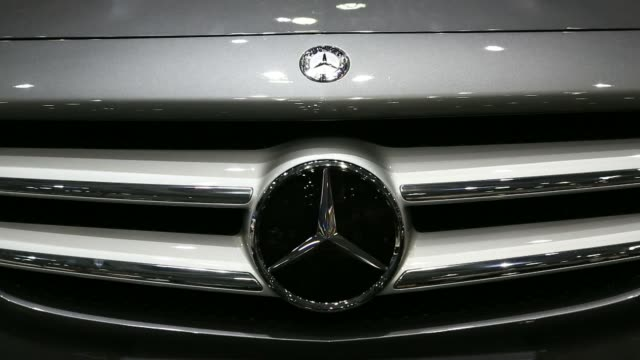 stockvideo's en b-roll-footage met a mercedes benz c220 blue tec vehicle produced by daimler ag sits on display during the press day of the 2014 busan international motor show in busan... - hybride voertuig