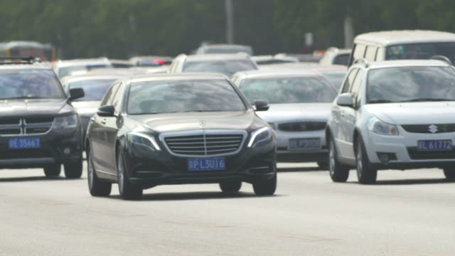 mercedes benz car stuck in traffic in beijing, china - mercedes benz stock videos & royalty-free footage