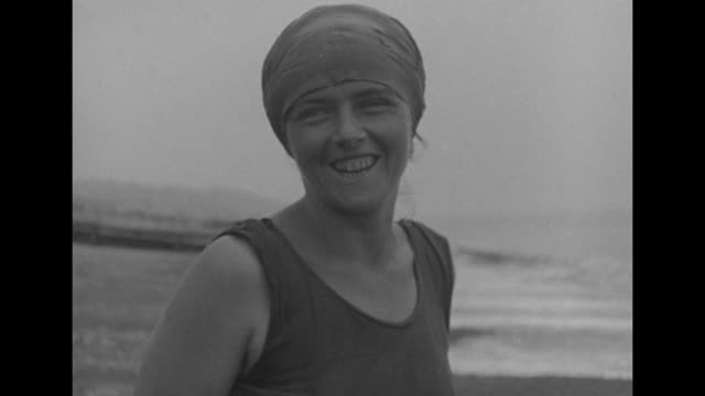 mercedes gleitze putting on bathing cap standing by shore of probably english channel during her training to swim the english channel / cu gleitze... - swimming cap stock videos & royalty-free footage