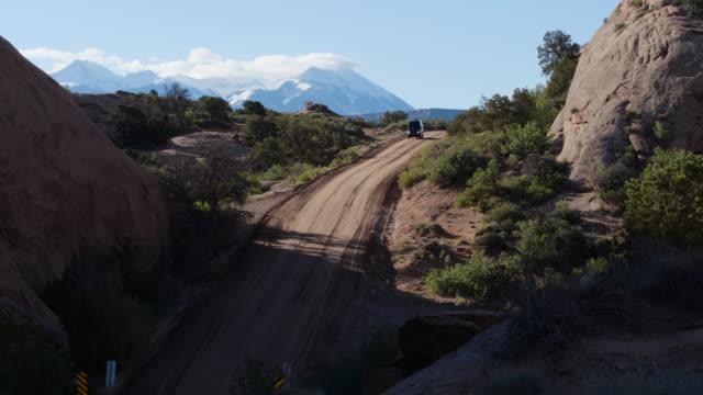 mercedes sprinter 4x4 van climbing a steep hill on dirt road in moab, utah - moab utah stock videos & royalty-free footage