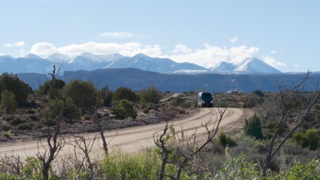 mercedes sprinter 4x4 van traveling on dirt road in moab, utah - moab utah stock videos & royalty-free footage