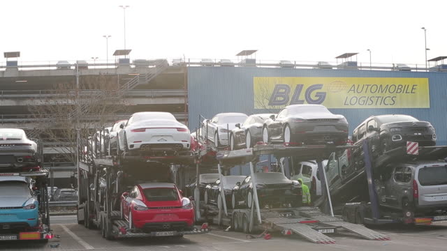 mercedesbenz bmw and porsches await shipping overseas as cars are loaded onto container ships for transport in bremershaven germany on tuesday... - mercedes benz stock videos & royalty-free footage