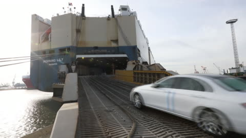 mercedes-benz, bmw, and porsches await shipping overseas as cars are loaded onto container ships for transport in bremershaven, germany, on tuesday,... - mercedes benz markenname stock-videos und b-roll-filmmaterial