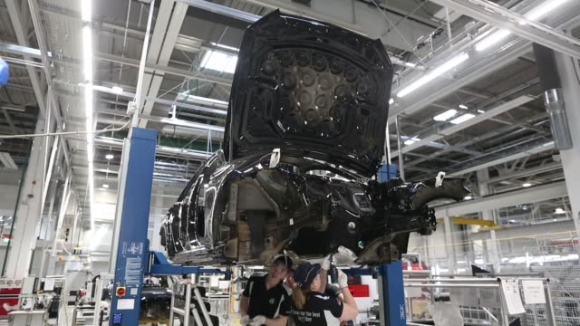 mercedes-benz e-class automobile on the production line at the daimler ag automobile plant in the yesipovo industrial park outside moscow, russia, on... - machine part stock videos & royalty-free footage