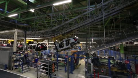 mercedes-benz gla compact suv automobiles, produced by daimler ag, are carried in cradles on the assembly line of the mercedes-benz factory in... - mercedes benz markenname stock-videos und b-roll-filmmaterial