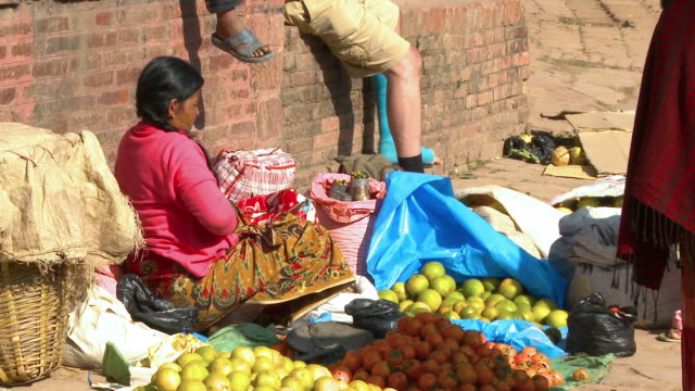 merchandise at a market in a village in nepal. - citrus fruit stock videos & royalty-free footage