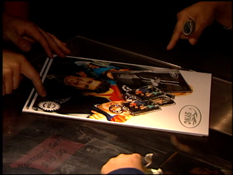 merchandise at the 'n sync concert at universal amphitheatre in universal city california on january 5 1999 - n sync stock-videos und b-roll-filmmaterial